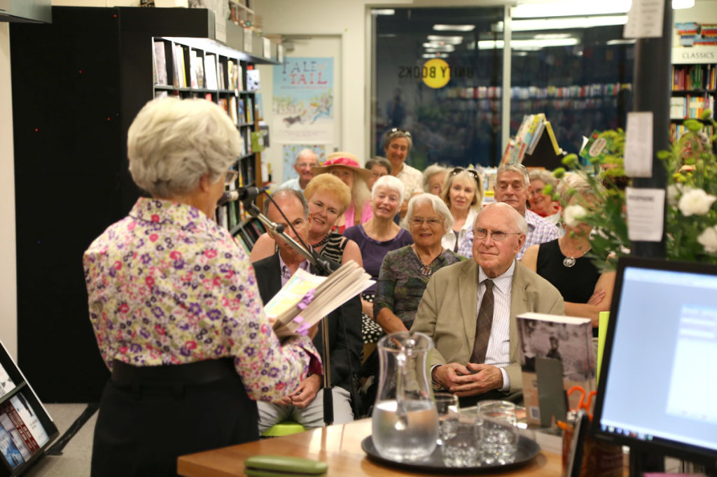 The crowd listens to Robin read from Hard Country