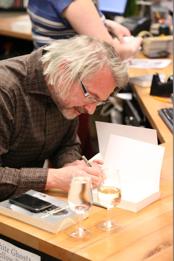 David Coventry signing copies of his book.