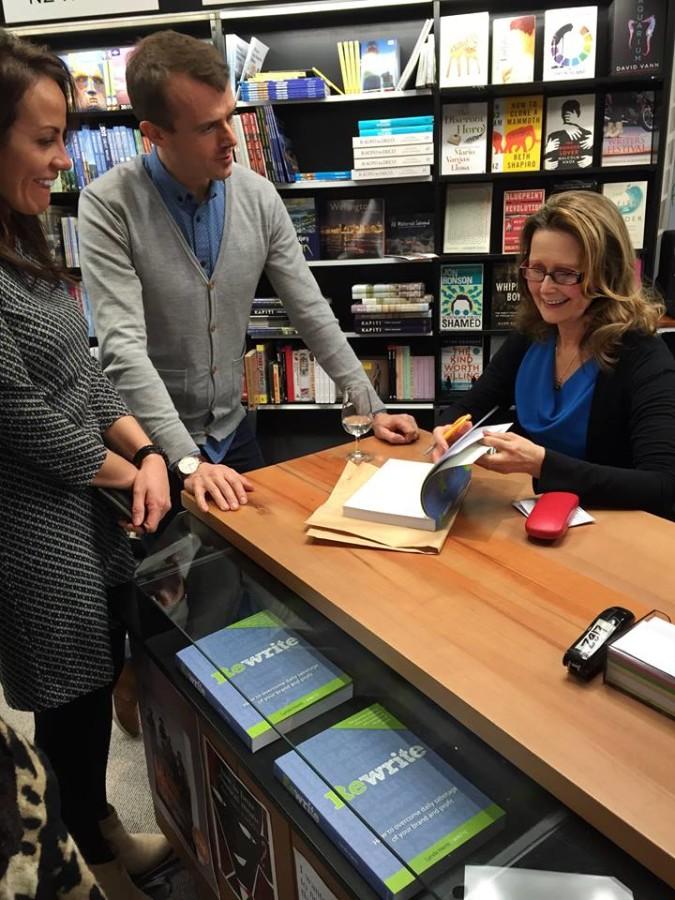 Lynda signing books